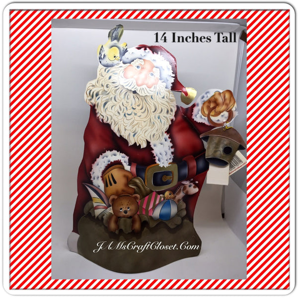 Vintage Tin Santa Standing With a Bird House Bird and Toys