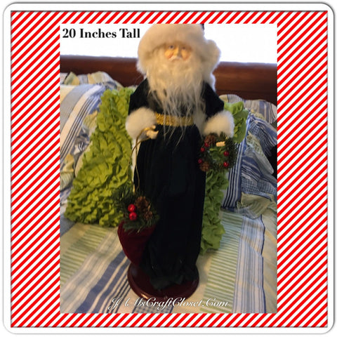 Vintage Table Top Santa in White and Green Holding a Wreath and Bag of Pine Cones and Berries