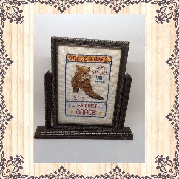 Shoe Advertisement Cross Stitch Grace Shoes  This Grace Shoes Cross Stitched Advertisement is in a Vintage Swivel Silver and Black Frame.  The frame itself does show some wear from its age and use but is the perfect frame for the shoe ad. JAMsCraftCloset