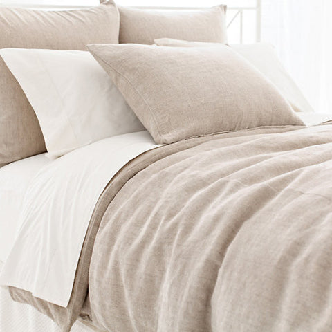 natural linen chenille duvet on bed with pillows