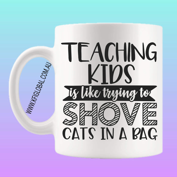 Teaching Kids is like trying to shove cats in a bag Mug Design