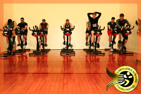Binghamton Triathlon Students ride in the spin bike room