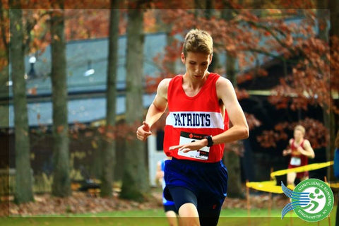 Noah Farrelly looks at running watch at 3 miles