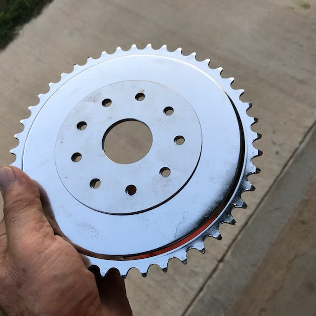 Clamp to spokes Chain sprocket alignment disc.