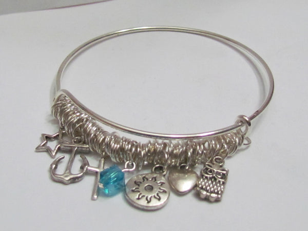 Expandable bangle bracelet, showing the charms laying flat.