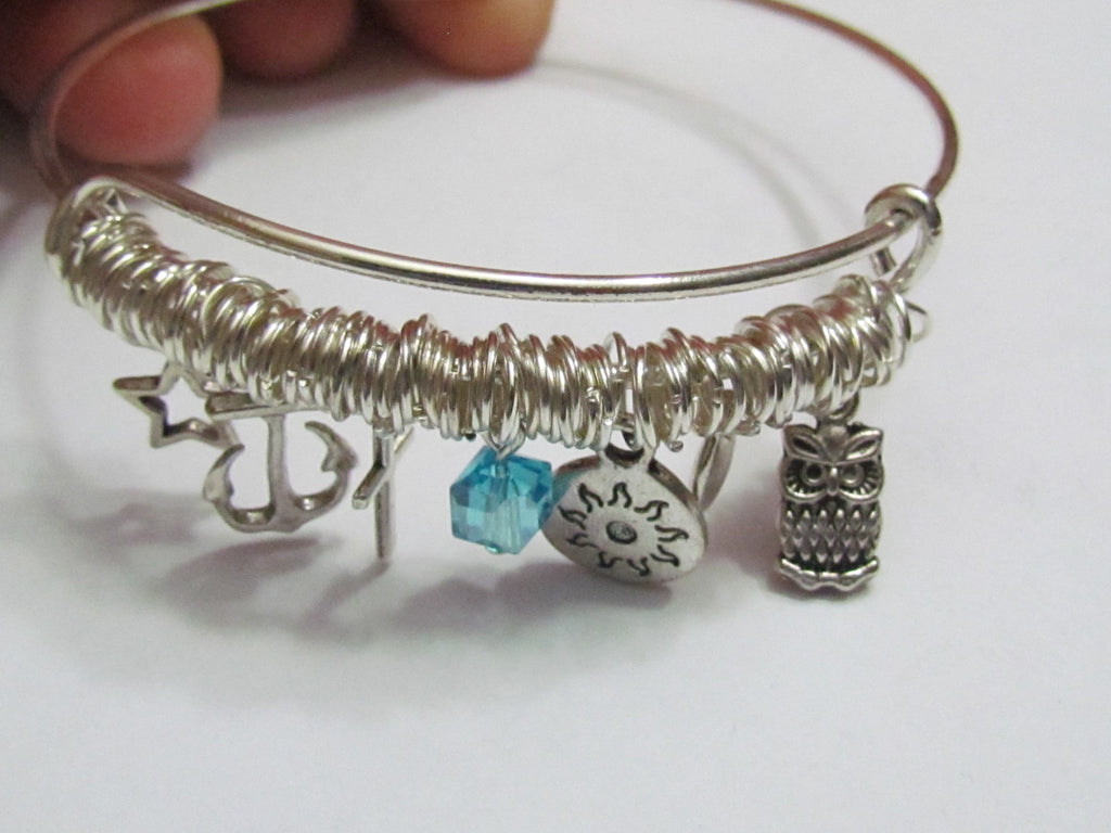Expandable bangle Charm Bracelet, variety of modern charms.