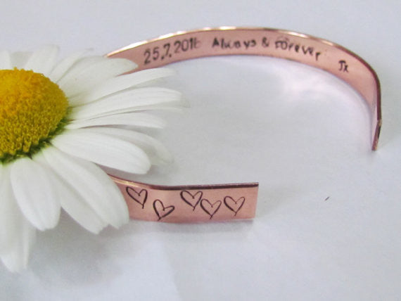 Copper heart cuff bracelet with saying stamped on the inside