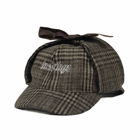 Buy Tuesdays Exploration Deer Stalker Hat Tweed. Soft 6 Panel construct, Silky Nylon lining. Approx fit 54-55 CM with slight flex. Top bow ear flap fastening. Contrast white stitch, Tuesdays Classic script embroidery. Fast Free UK and Europe Delivery/Shipping options. Buy Now pay Later with Klaran or Clearpay | Tuesdays Skate Shop | Bolton Greater Manchester United Kingdom.