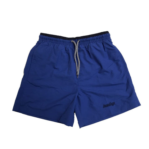Buy Tuesdays Icon Swim Shorts Blue/Navy. Contrast Red embroidered Script detailing on left leg. Drawstring adjustable elasticated waistband. Mesh Lined, Trunks style. Slit Side pockets w/ Flat back pocket (Velcro closure). Fast free UK delivery available, Free European shipping available. Worldwide Shipping. Skateboarding Shorts.