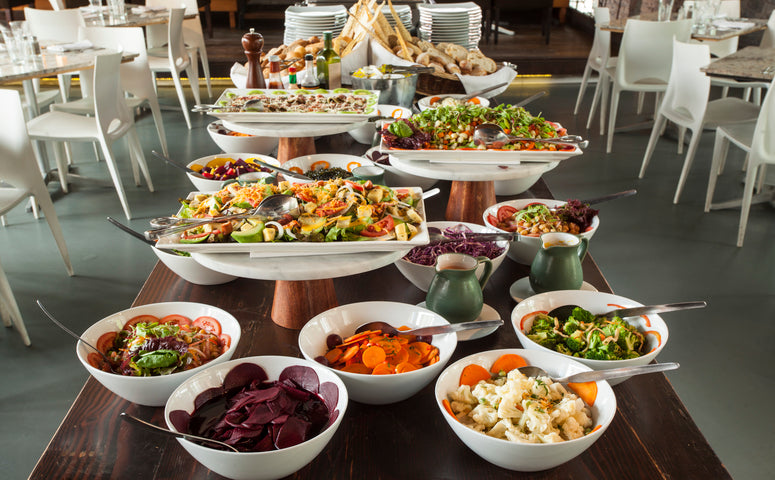 Buffet with diverse salads, desserts, soups
