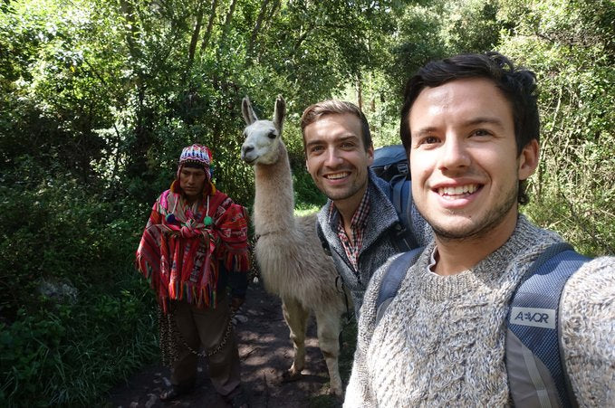 Exploor Peru Founders Erik and Oliver hiking with a llama and a local