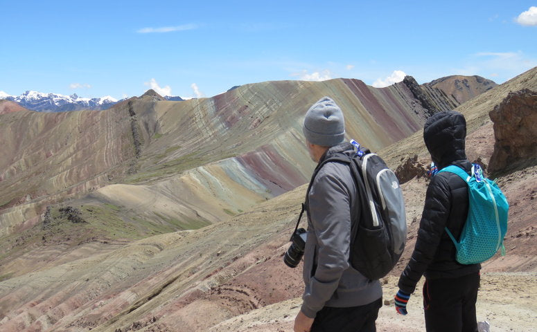 Explorer looking at the Palccoyo Rainbow Mountain