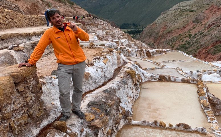 Exploor Peru Guide Carlos at Maras Salt Mines Cusco