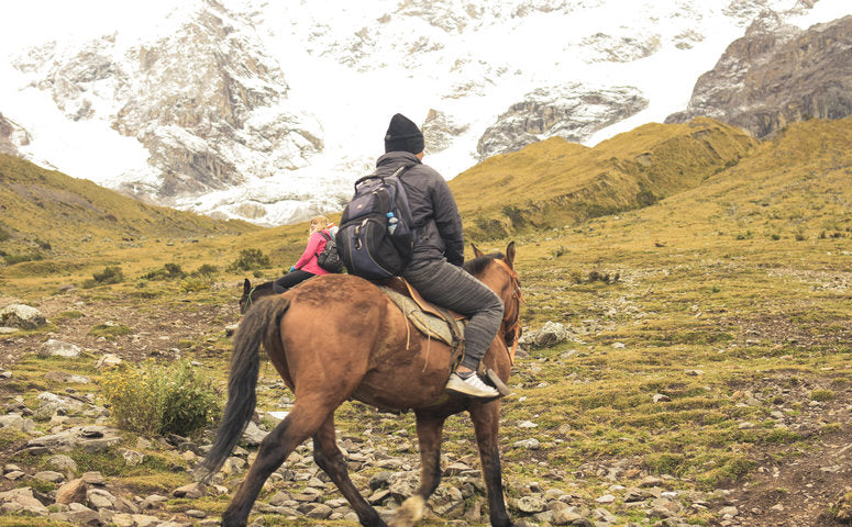 Traveler on horse on the way to Humantay lake