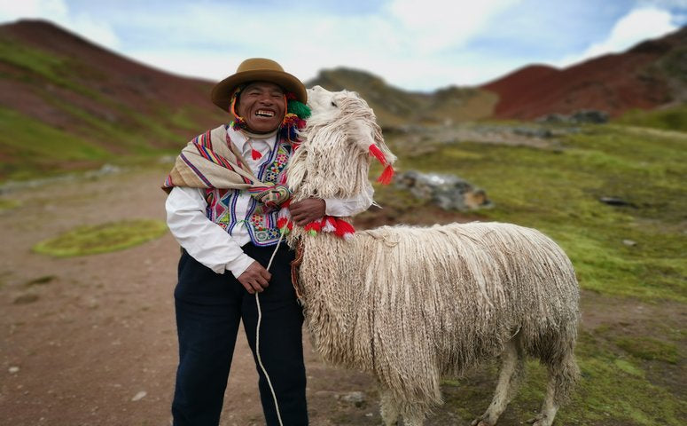 Local person holding his llama Jorge