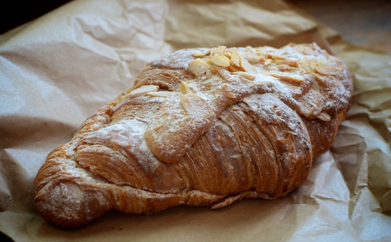 Almond Croissant with powder and almonds on top