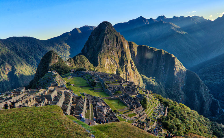 Machu Picchu with sun and blue sky