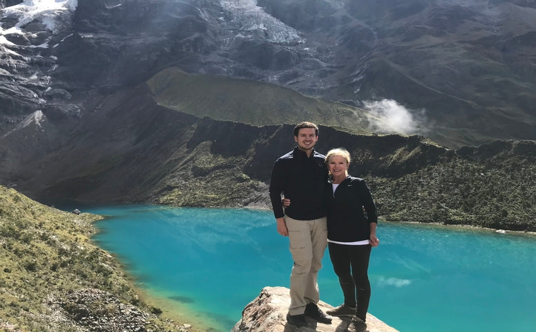 Mother and Son standing in front of the Humantay Lake