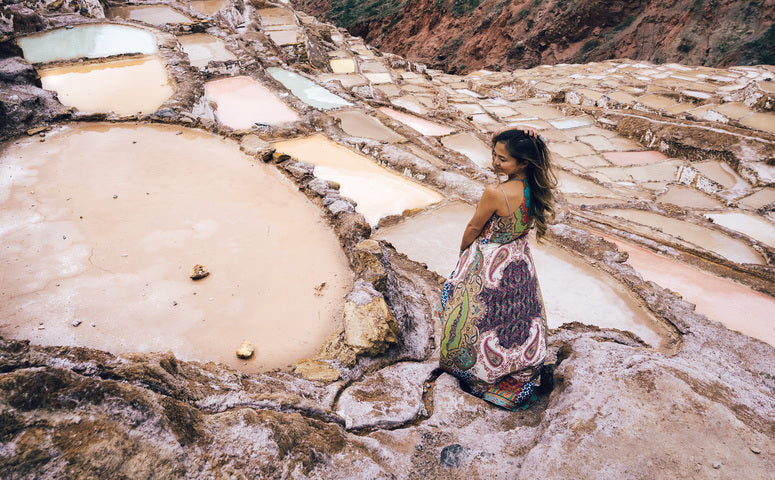 Influencer Krystine standing at Maras salt mines