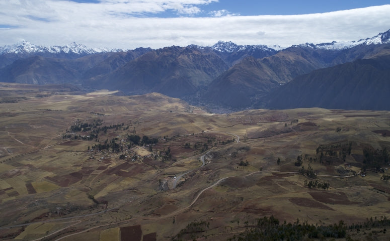 View at the Sacred Valley landscape with snowed mountain edges in the background