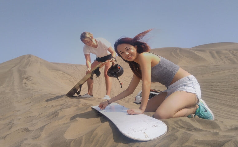 Two Girls sandboarding in Lima