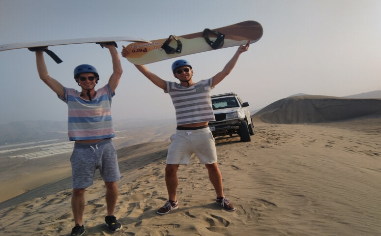 Two guys sandboarding in Lima