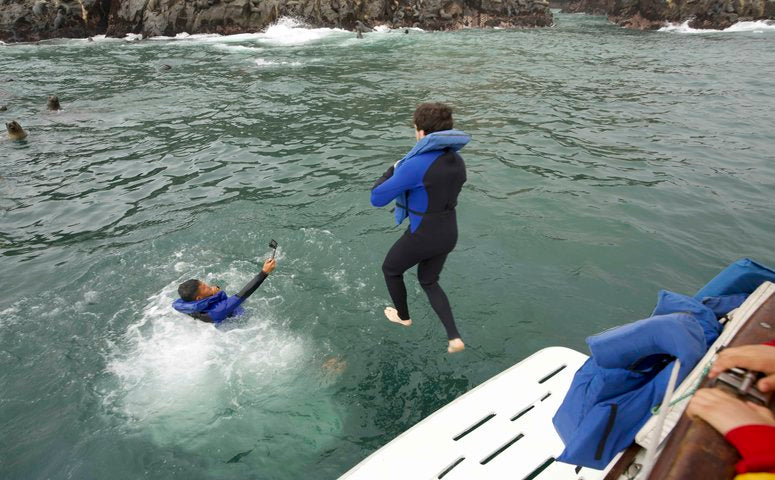 Jumping in the pacific ocean from the boat