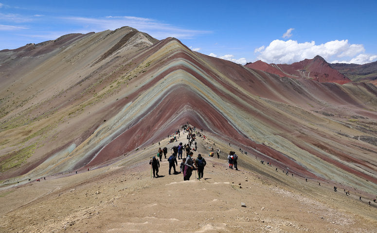 Vinicunca Rainbow Mountain with many travelers