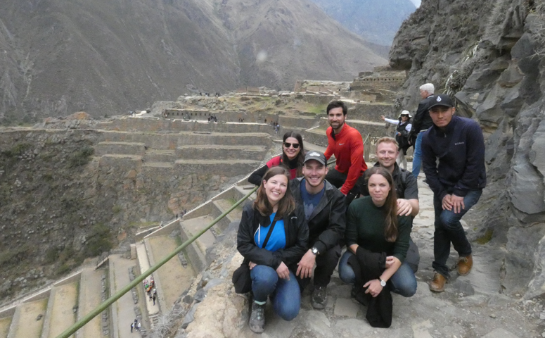 Small group of Explorers at the sun terraces of Ollantaytambo.