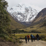 Small group walking towards Salkantay mountain