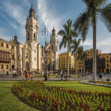 Plaza de armas with ancient buildings and garden