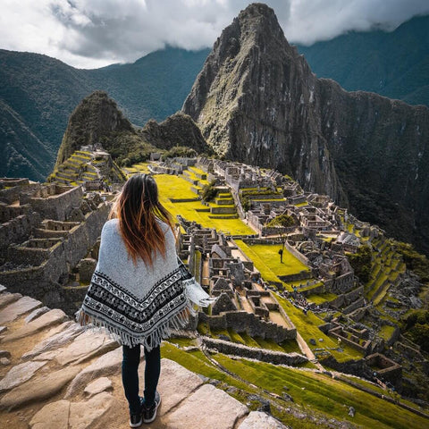 Girl looking at Machu Picchu ruins