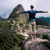 Guy overlooking Machu Picchu Cusco