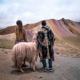 Couple with llama at Palccoyo Rainbow Mountain tour Cusco