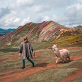 Guy with llama in front of Rainbow Mountain