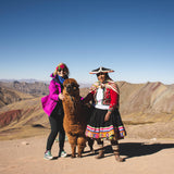 Lady with alpaca and local at rainbow mountain
