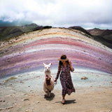 Girl with llama on alternative rainbow mountain