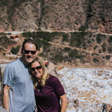 Couple in front of Maras salt mines during Sacred Valley day tour
