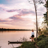 Girl at Amazon river enjoying sunset