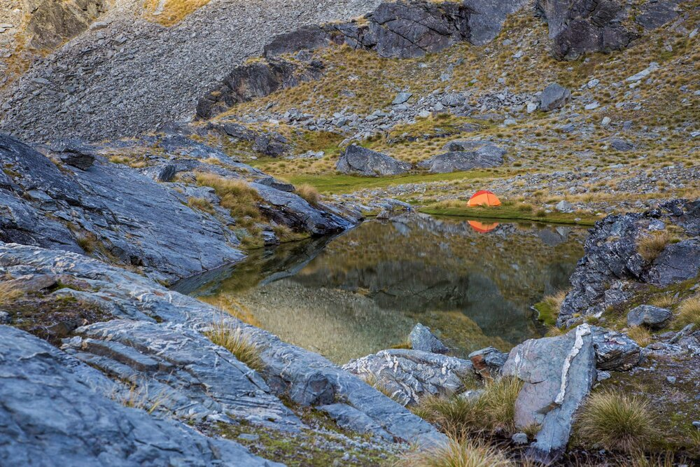 Alpine camping by a tarn