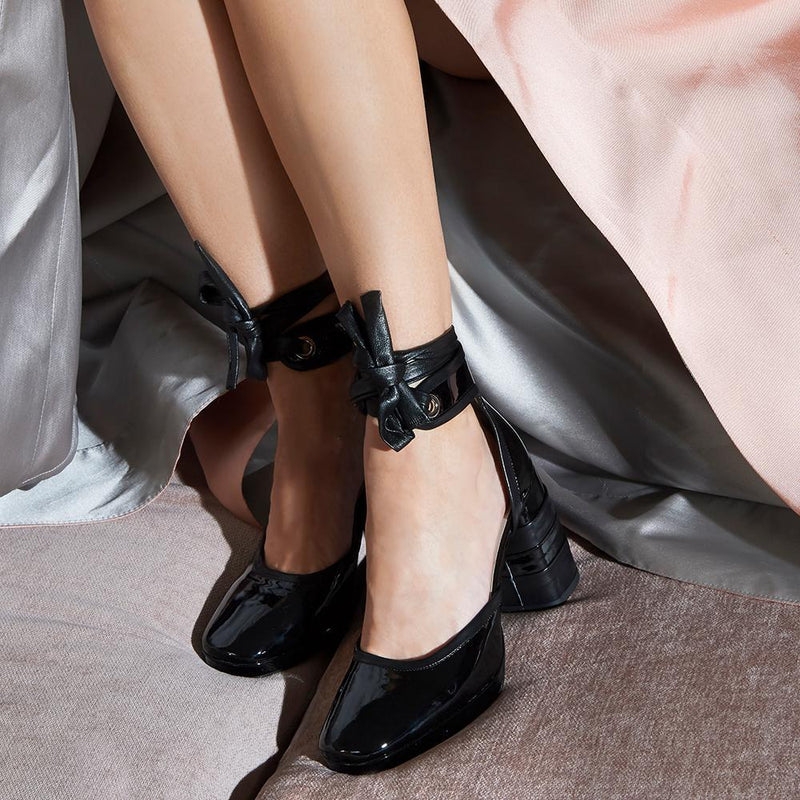 Woman Wearing Daniella Shevel Women's Square Toe Pump in Black Leather with Leather Ankle Strap