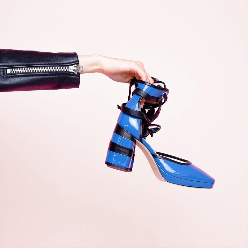 Woman Holding Daniella Shevel Women's Square Toe Pump in Blue Leather with Leather Ankle Strap