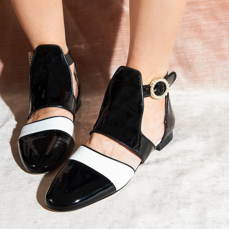 Woman Wearing Daniella Shevel Women's Sandal in Black and White Patent Leather with Pearl Accents