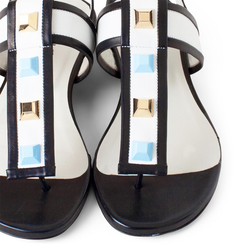 f794016fd53 ... Daniella Shevel Women s T-Strap Sandal in Black and White Leather with  Blue and Gold