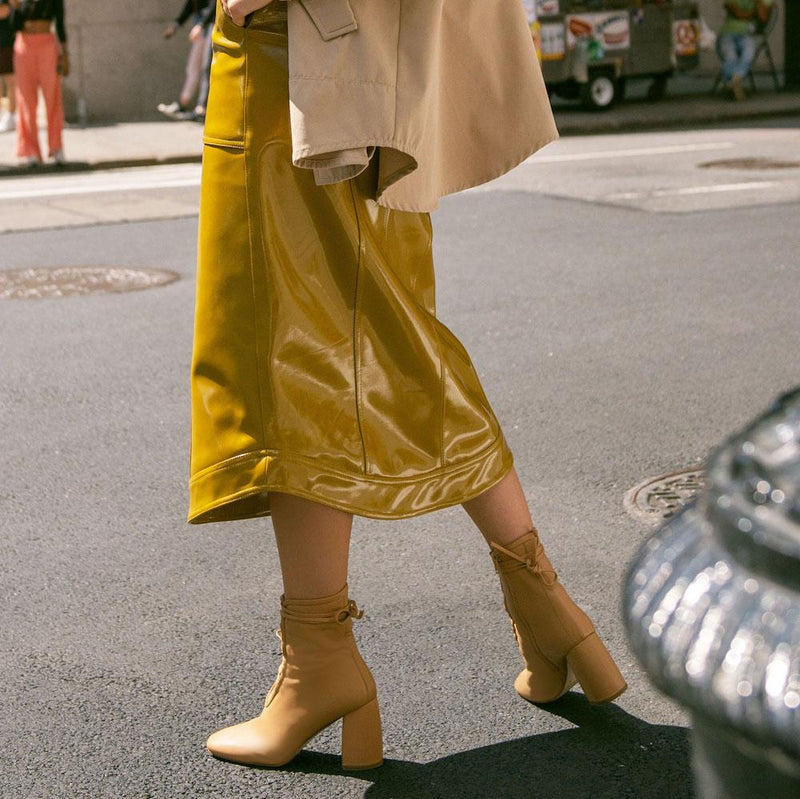 Daniella Shevel BellaDonna Camel Leather Boot with Heel and Camel Laces on Woman with Yellow Skirt Streetstyle