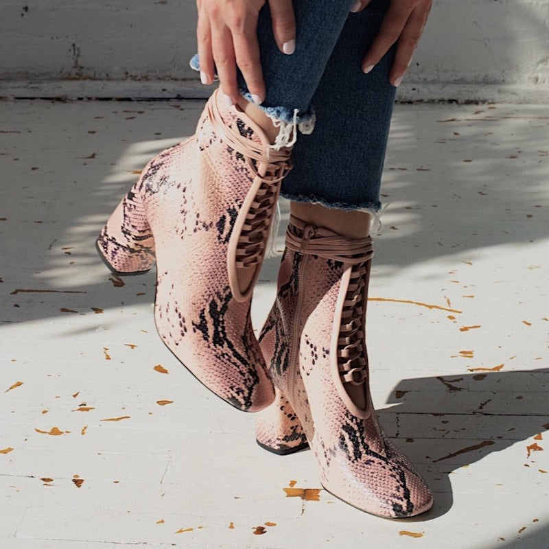 Daniella Shevel BellaDonna Pink Printed Snake Leather Boot with Heel on model with denim jeans look