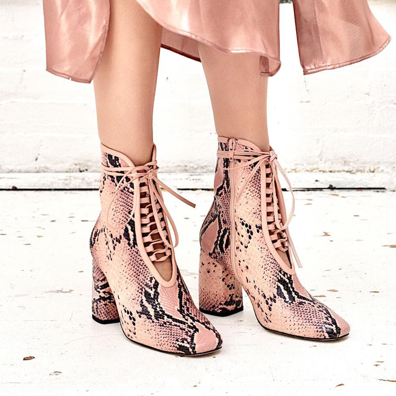 Daniella Shevel BellaDonna Pink Printed Snake Leather Boot with Heel on model with satin skirt look