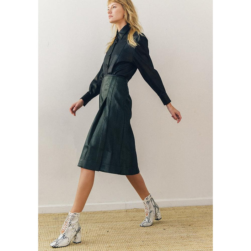 Daniella Shevel BellaDonna White Printed Snake Leather Boot with Heel on model with green leather skirt
