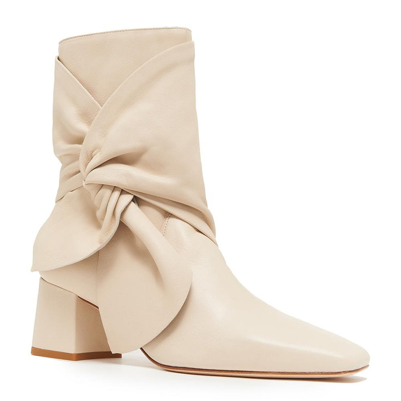 Daniella Shevel Bonnie Bow Tie Bootie side angle view in Stone White Cream