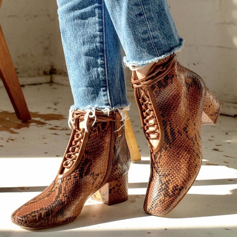 Daniella Shevel Cleo Brown Printed Snake Leather Boot with low Heel on model with denim jeans